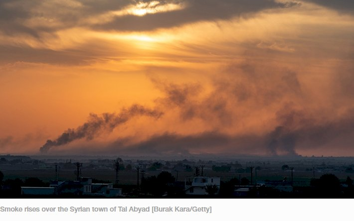 AKCAKALE, TURKEY - OCTOBER 10: Smoke rises over the Syrian town of Tel Abyad, as seen from the Turkish border town of Akcakale on October 09, 2019 in Akcakale, Turkey. The military action is part of a