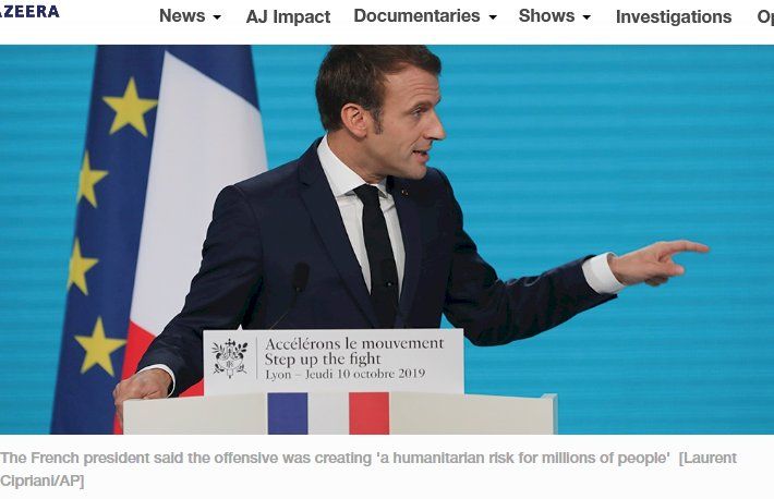 France's President Emmanuel Macron gestures as he delivers a speech at the Lyon's congress hall, central France, Thursday, Oct. 10, 2019, during the meeting of international lawmakers, health leaders